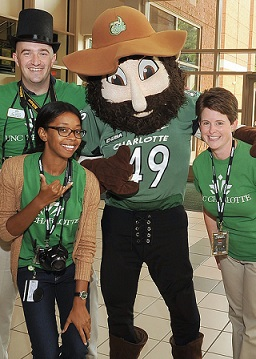Staff members with Norm at past Giving Green kickoff